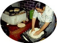 Woman in Michoacan mixing 'masa harina' to make tortillas