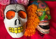 Pic 5: Marigolds appear in the eyes of Mexican Day of the Dead paper mâché skulls and masks...