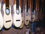 Pic 20: A line of armadillo-shell-backed charangos in the workshop of Bolivian maestro Sabino Orozco, La Paz, 1975