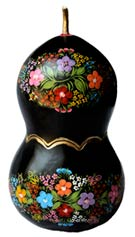 Pic 3: Lacquer painted bottle gourd from Chiapa de Corzo, Mexico; note that the central wavy gold line indicates where the top half comes off...