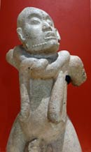 Pic 5: Late Classic limestone sculpture of a male facing upwards. The scarifications between his eyebrows and on his cheeks are symbols of shamanic initiation; round his neck is a knotted rope, identifying him as a shaman in a trance. MNA, Mexico City