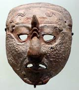 Pic 7: Late Classic Maya Jaina ceramic ritual mask, showing facial markings typical of shamanic practices and sorcery. The sign on his face symbolises a portal into the underworld. Museo Nacional de Antropología, Mexico City