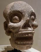 Pic 9: Late Classic fleshless stone head sculpture from Uxmal, representing the Maya god of death. Museo Nacional de Antropología, Mérida