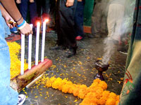 Secondary school students add incense and cempoalxochitl flowers to their 'ofrenda'