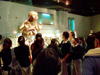 Students face-to-face with Mictlantecuhtli in the Templo Mayor Museum