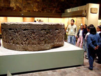 Students view the original Tizoc Stone, Museum of Anthropology, Mexico City