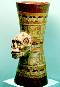 Pic 14: Mixtec goblet with skull relief, painted top and bottom with stars (half-open 'eyes of the night')