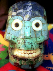 Pic 12: A modern version of a turquoise skull mask (though on a wooden base!) from Oaxaca, used by the Mexicolore team in hundreds of school workshops on the Aztecs