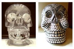 Crystal skull alongside a modern Mexican papier maché sull