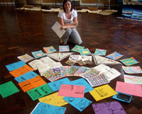Claire Davis with examples of pupils' string paintings and designs based on 'The Shawl'