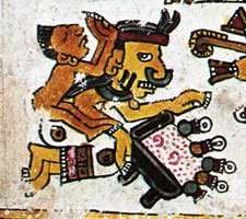 Pic 6: Grinding corn on a stone 'metate' in a Mixtec codex: learn more about the metate using the link below
