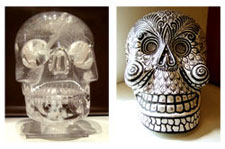 Rock crystal skull (British Museum) alongside a modern Mexican papier maché sull