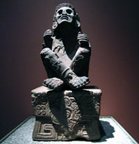 Stone figure of Xochipilli ('Prince of Flowers'), god of music