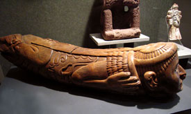 A fine original Aztec wooden teponaztli slit-drum carved in warrior shape, National Museum of Anthropology, Mexico City
