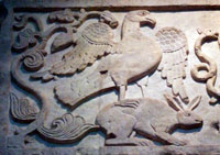 Detail from a marble panel from Constantinople, c. 950 CE: an eagle fighting a serpent stands on a hare; some interpret the scene as Christ (eagle) carrying a Christian soul (hare) to Paradise. British Museum