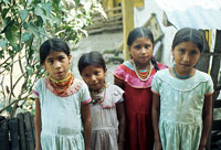 Pic 6: Girls standing near their village schoolhouse. They are getting ready to go to school.
