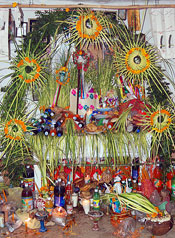 Pic 10: Contemporary Aztec altar constructed as part of a pilgrimage to a sacred mountain.  The offerings are dedicated to various deities to promote crop fertility. The arch represents the celestial realm, decorated with pinwheels representing stars.