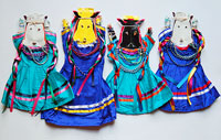 Pic 18: Close-up of paper images of seed spirits. Each doll is composed of several paper cutouts stacked on top of each other representing maize, chile peppers, and beans among other crops.