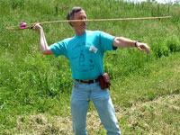 John Whittaker throwing a dart with an atlatl