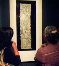 Mexicolore team members study the Codex Moctezuma
