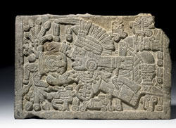 From a jar Tlaloc pours streams of water rich in symbols of fertility; on the inside of this stone casket in the British Museum is an ahuitzotl figure