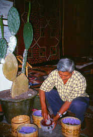 Preparing cochineal and other natural dyes by hand in a Oaxaca textiles workshop