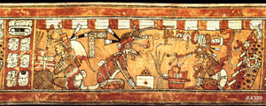 Pic 4: A bundle of folded cloth (left), feathers and jade make an offering being presented to the Maya god Itzamná; clay polychrome vase, Alta Verapaz