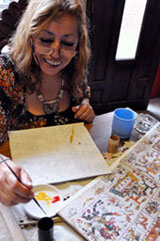 Pic 3: Dinorah continues to hand paint codices today...