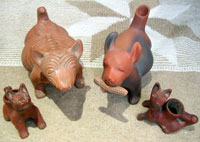 Pic 6: Copies of pre-Hispanic Mexican dog figurines; notice the corn cob in the mouth.