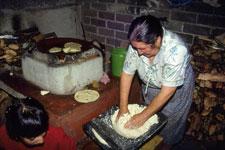 Pic 4: 'Con las manos en la masa...': kneading dough for tortillas, Michoacán, Mexico, 1980s