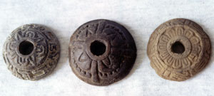 Pic 5: Ceramic spindle whorls with sun and flower motifs from Xaltocan, Mexico