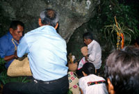 Pic 5: People dedicating offerings at the cave of the water spirit.