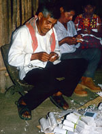 Pic 7: Nahua ritual specialists cut paper images of the spirits.