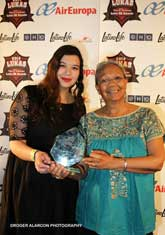 Mexicolore team member Joanna Sotres and director Graciela Sánchez holding the 2014 LUKAS award