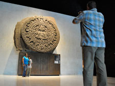 Pic 16: A Mexican family pose with the Sunstone in the Mexica gallery of Mexico's National Museum of Anthropology