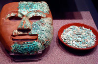 Pic 7: Model of Aztec ceramic mask half covered with turquoise mosaic pieces ('tesserae'); National Museum of Anthropology, Mexico City