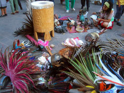 Pic 13: A 'danzante' pauses to tend instruments and other artefacts used in Concheros ceremonies. Can you spot the 'concha'?
