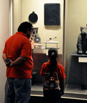 Pic 13: A father and daughter visit the Templo Mayor Museum in Mexico City; note the obsidian mirror!