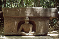 Pic 5: Giant Olmec stone sculpture at La Venta: the front of Altar 4 appears to depict a ruler figure and his throne, bearing strong feline imagery