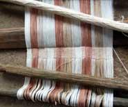 Back-strap loom with natural dye colours, from women's weaving co-operative, San Juan La Laguna, Guatemala, 2010