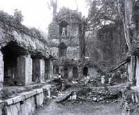 Pic 16: Alfred Maudslay standing in the ruins of the Maya city of Palenque
