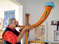 Pic 4: Roberto Velázquez Cabrera demonstrates how to play a Maya gourd trumpet