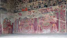 Pic 8: Teotihuacan, Tetitla apartment compound. The deity images in this mural wear green feathers in elaborate bird headdresses