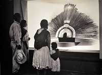 Pic 2: An old anonymous photo on display today in Mexico City's National Museum of Anthropology of a Mexican Indian family admiring the splendid replica of 'Moctezuma's headdress' soon after it was put on public display