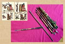 Pic 2: Miniature Mexican bow and arrows, with pictures from codices of rulers showing off their archery skills