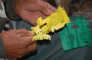 Pic 13: Encarnación (Cirilo) Téllez Hernández separates paper images of disease-causing winds