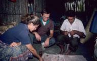 Pic 14: Pamela Effrein Sandstrom and Alan R. Sandstrom interview ritual specialist Encarnación (Cirilo) Téllez Hernández as he cuts paper figures