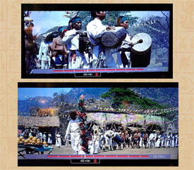 Scene from The Magnificent Seven in which an Aztec-style vertical drum is played in a procession