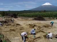 Pic 4: Terminal Formative period patio group from the site of Tetimpa, Puebla. The site was covered by the eruption of Popocatepetl, in background, during the first century AD