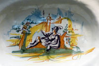 Pic 16: Caricature of Spanish conquistador in armour, ceramic dish, possibly 16th century, Real Alcázar, Seville